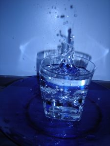 water in glass splash